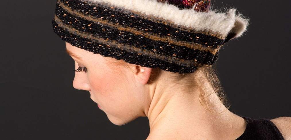 Wool hat in browns and gold with ivory trim