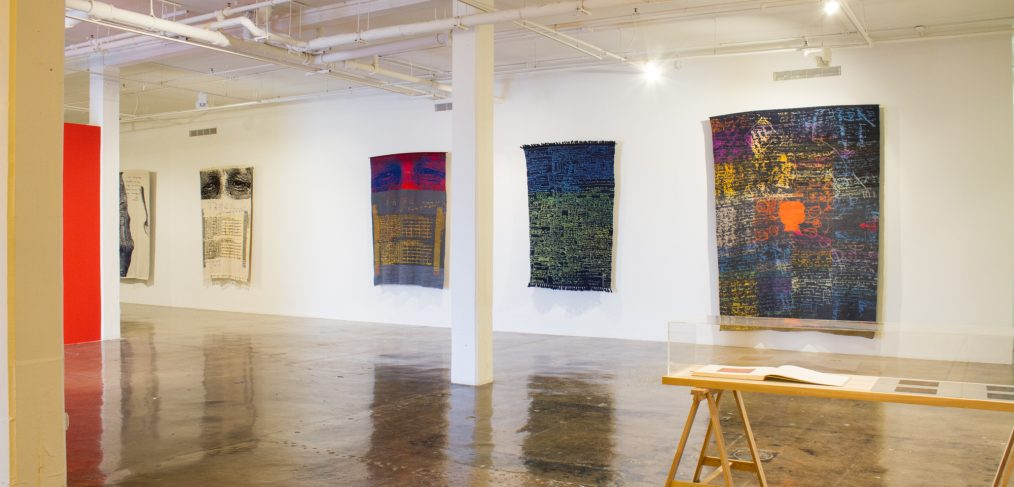 Installation view of large rugs at Blue Star Contemporary in Austin, TX